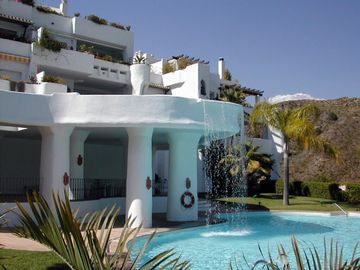 Nueva Andalucia apartment rental - Cascading waterfall - Lomas pool