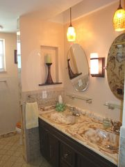 Pompano Beach villa photo - Master bath has double sinks, combination tub/shower and vanity area.