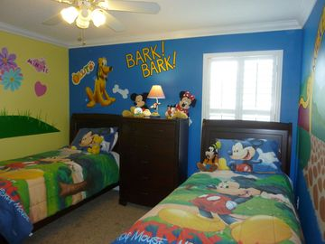 Disney Bedroomainted with a classic Disney theme. It has a 32 inch HDTV