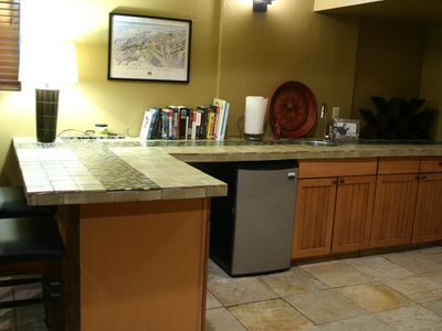 Game room, showing the wet bar and miniature refrigerator