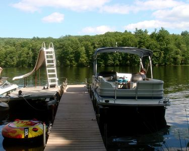 Dock area water slide and pontoon boat (boat can be rented for $950.00/week).