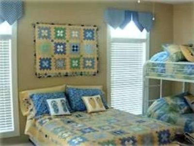 Kids room on lower level w/handmade quilt, bunkbeds & TV w/DVD.
