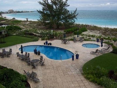 Step out patio door onto pool complex and the Grace Bay Beach just steps beyond.