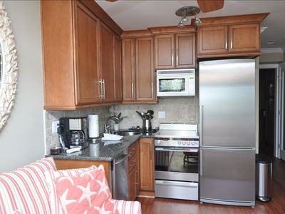 Kitchen, new custom cabinets, frig with ice maker, stove with warming drawer