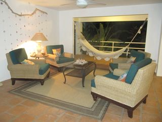 Vieques Island house photo - Downstairs covered patio seating area.
