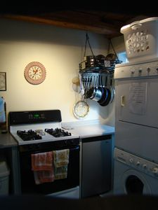 Gas stove. Well equiped kitchen with pots and pans