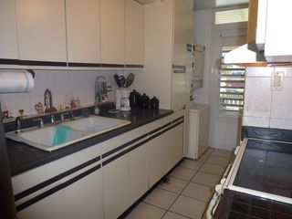 Dorado villa photo - Fully equipped kitchen... washer and dryer in the back porch.