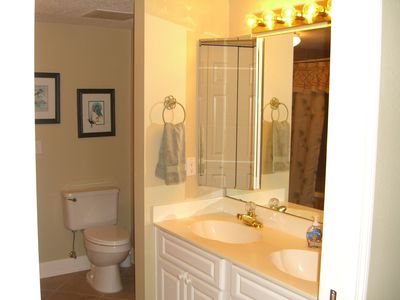 Bathroom with deep soaking tub and two sinks. There is a large walk in closet.