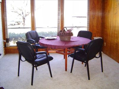 2nd of 4 dining areas, doubles as a game table with a lake view!
