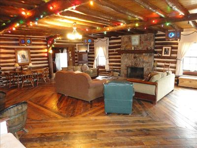 Bear cabin inside with stone fireplace and large gathering room.