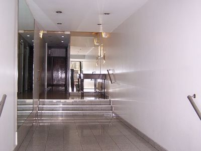 APARTENT LOBBY WITH TWO ELEVATORS & PORTERS ON DUTY