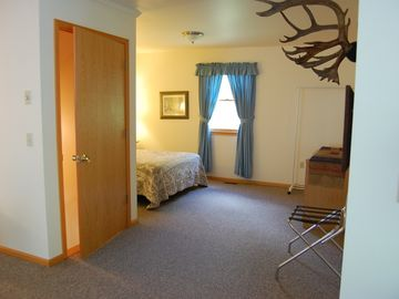 entrance from first floor - queen bed with new spread