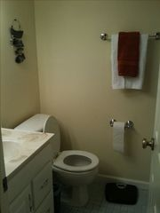 New Smyrna Beach condo photo - Guest Bath. Washer in Dryer in guest bath. Shower.