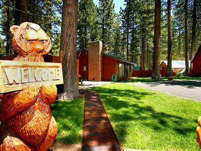 Our Welcome Bear invites your to the Bears Den Cabin