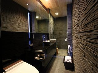 The luxury bathroom, lined with black granite and cypress, offering you to relax - Kyoto townhome vacation rental photo