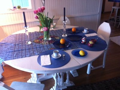 Big round dining table with seating for six