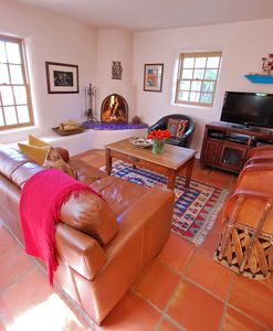 Living Room Features Saltillo Tile Floors and a Cozy Kiva Fireplace