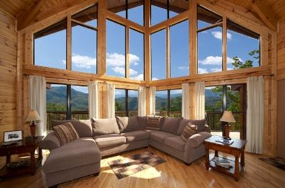 Look what you see when you enter. Floor to ceiling glass to enjoy the Smokies !!