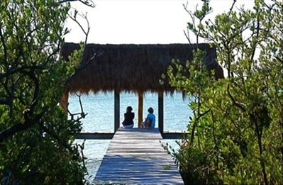 A private palapa on the lagoon, with walkway