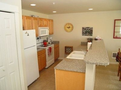 Fully stocked kitchen includes granite counter tops