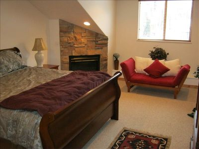 Master Bedroom. Very comfortable king bed. Gas fire place. Futon sofa/sleeper