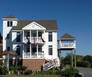 Chincoteague Island house rental - elegant waterfront vacation residence Moorings North welcomes you