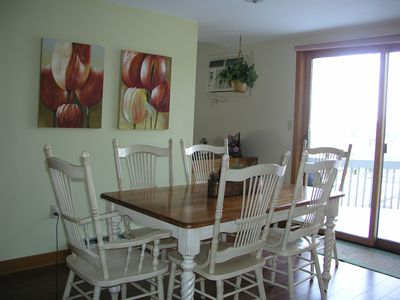 Dining room seats six with easy access to outdoor deck.