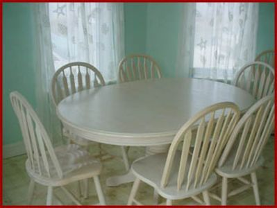 Kitchen table-eight chairs total