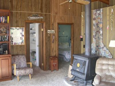 View of Living Room with wood stove & bedrooms