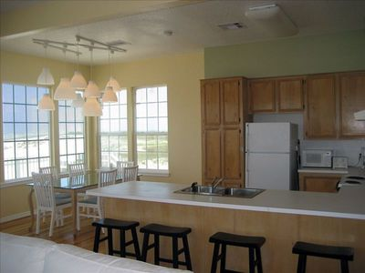 Galveston house rental - Kitchen with pots, pans, fridge, stove/oven, and a view
