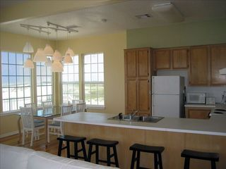 Galveston house photo - Kitchen with pots, pans, fridge, stove/oven, and a view