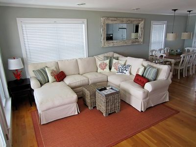 living room includes ample seating and plush down sofa.