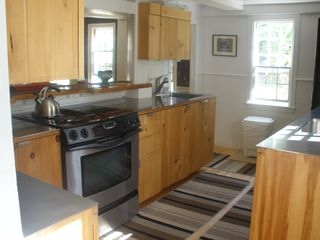Dennis Village house photo - Modern kitchen has Jenn-Air stove, two sinks and dishwasher. Opens to 18th c. DR