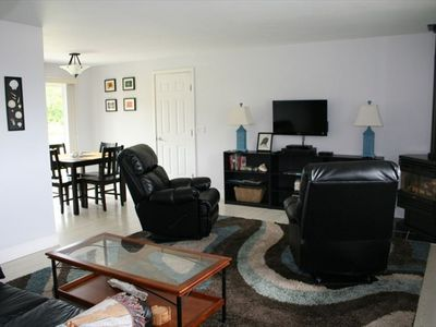 Comfortable living room with gas fireplace and flat screen TV . And what a VIEW!