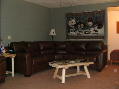 Sectional with 2 recliners, 2 fly tie table stations, Flatscreen TV.