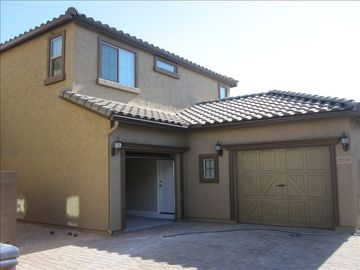 Desert Ridge Scottsdale house rental - Back side of home with driveway and use of larger garage.
