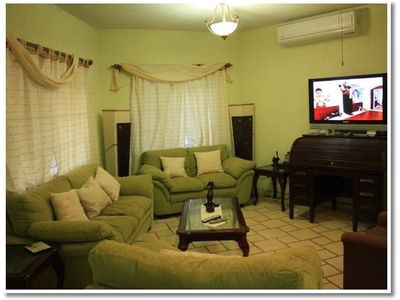 "Living room, 4 sofas, 40"" TV with Cable, DVD, Air Conditioner"