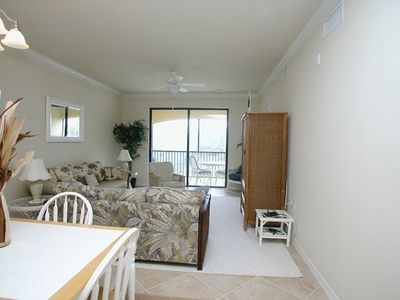 Living Room has TV and Full size Sleeper Sofa - Screened in lanai w/Lakeview