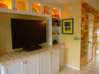 Key West condo photo - Entertainment center and door to first floor bathroom.