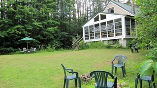 Hillsborough cottage photo - Enjoy campfires at night or the spacious lawn area which borders the water.