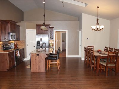 Large open designed kitchen dining, table seats 8 with comfort.