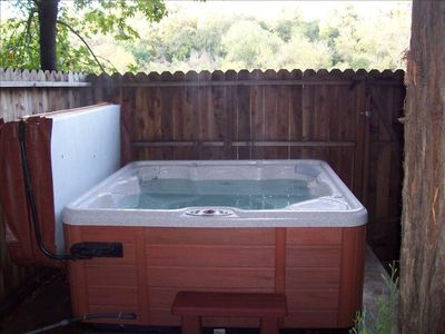 Large 4 person hot tub under the Redwood Tree, very private.