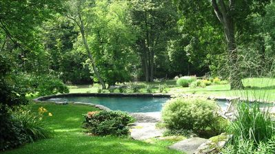 In warmer months - the pool is surrounded by gardens and can be heated.