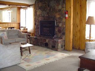 Gaylord cabin photo - living room with fire