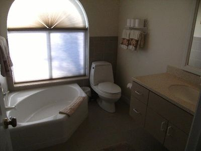 Guest bathroom with corner tub