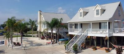 Gulf Shores house rental - View of the Saint Lucia and Antigua bungalows, and our new volleyball court.