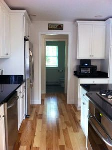 Kitchen with high end refrigerator, dishwasher, stove and oven.