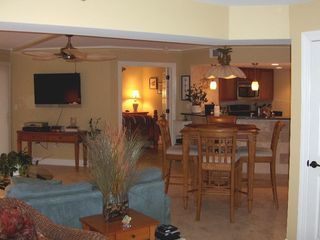 Palmetto Dunes condo photo - Greatroom with 42' HDTV, ceiling fan, pub table. Kitchen in the background.