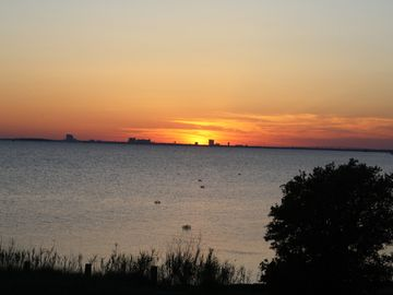 The Sun sets over Biloxi. When darkness comes this becomes sparkling lights.