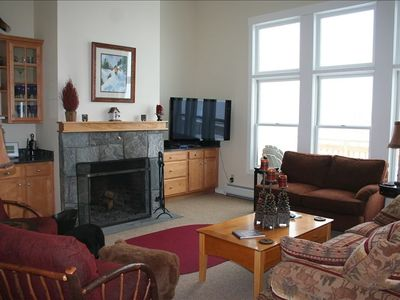 "Great room with wood burning fireplace and a 50"" High-Def Plasma TV"